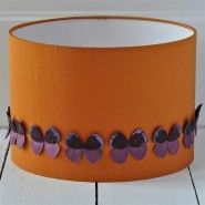 Burnt orange silk lampshade with a row of individually hand made purple butterflies.  	30cm x 20cm table  	100% silk, ..