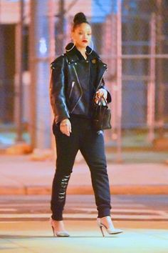 Rihanna wearing Celine Mini Boston Bag, Balenciaga Swing Biker Drop-Shoulder Leather Jacket and Balenciaga Slash Triple-Strap Leather Pumps in Black