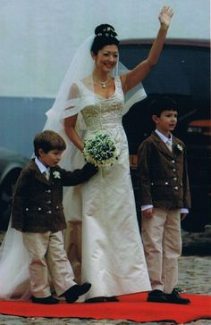 The Countess of Frederiksborg at her wedding to Martin Jorgensen. This was her second walk down the aisle, her first being to Prince Joachim of Denmark.  Alexandra's two sons,   Prince Nikolai and Prince Felix escorted her down the aisle.