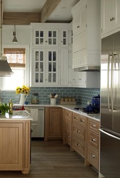 White and Wood Kitchen. Watery Blue backsplash