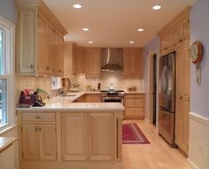 Maple Cabinets, light countertop, light floor, like the pantry cupboard next to fridge.