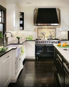 White cabinets black counter, black island white counter, dark floors. - Kitchen