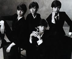 "Vogue's ""Fab Four,"" from left: Fanni Bostrom as John Lennon, Audrey Marnay as Ringo Starr,Tasha Tilberg as Paul McCartney,andTrish Goff as George Harrison. - Photo: Steven Meisel, Vogue, November 2001"