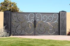 Driveway Gate this site has lots of unique iron gate options... luv, luv, luv this gate! copper? could we accommodate to hinge up?