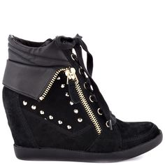 Feel the heat in the edgy Hitzo by Guess.  This super cute sneaker wedge features a black suede upper with studs and zippers detailing the silhouette.  A lace up vamp and 3 inch wedge finishes off this everyday look.
