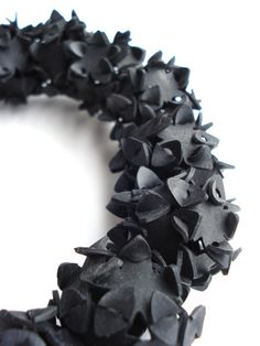 rubber necklace handmade with innertubes  Inner tubes rubber is soft lightweight material, so they can be worn without being noticed too much.   Size: 50 cm  The innertube is cut into 12 flower shapes. After interlocking they together form al ball. The necklace is elastic. Everyone can wear it. More on www.barbaratenbhomer.nl