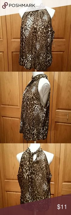 S.L.B. Leopard Sleeveless Blouse Gathered on the front up to the neck with backside having a hey hole with tie. Loose fitting and flowing. 100% polyester. Tagged XL, the breastline across laying flat measures 22 inches. Length about 25 inches. Super cute and versatile. No flaws or signs of wear. S.L.B. Tops Blouses