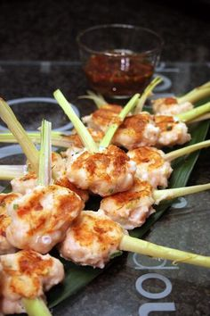 Prawncakes on Lemongrass Skewers.  I've had these on sugarcane skewers at my favorite Pho joint and they rock!