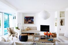 White living room with woven light fixture