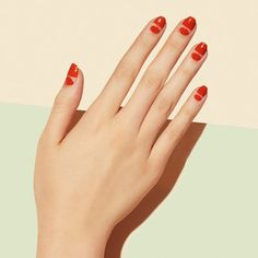 Last fall was all about the half moon along the cuticle. This year, mix the moon design with a half-painted nail for a fresh take on the old trend.
