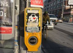 lovebot sticker on a yellow sign by the button one pushes when one wants to cross at a streetlight. Yellow Sign, Landline Phone, Robot, Sticker, Button, Art, Art Background, Kunst, Stickers