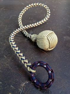 Micro paracord monkey& fist 1 inch SKF® steel ball with a long stitched 4 strands square braid. Cord used is from Atwood Rope MFG.different way to do a paracord bracelet Rope Knots, Macrame Knots, Paracord Bracelets, Beaded Bracelets, Paracord Keychain, Survival Bracelets, Monkey Fist Knot, 550 Paracord, Paracord Ideas