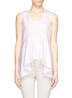 This waterfall ruffle peplum top from Chloé will flatter your upper half with effeminate volume. For the best outcome, pair it with high-waisted skinny jeans to balance out its crisp and airy look.