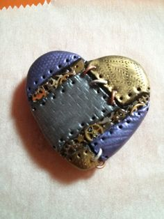 This is the a Beating Gears Heart from my collection. Polymer clay and watch gears.