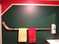 Cute idea for boys bathroom with race car parts. Hockey Stick towel bar for bens future man cave Sports Bathroom, Man Cave Bathroom, Downstairs Bathroom, Bathroom Small, Hockey Decor, Hockey Room, Hockey Man Cave, Ice Hockey, Theme Sport