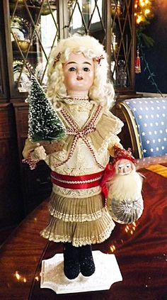 one of my antique doll candy containers that I made in 2012. There are two others that match her that I made and sold in 2011