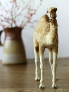 A fine needle felted camel suitable for Christmas nativity decor   Made with real camel wool and sheeps wool felted around a pose-able wire armature