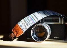 Oh my word. I am in love. I must have this camera strap.