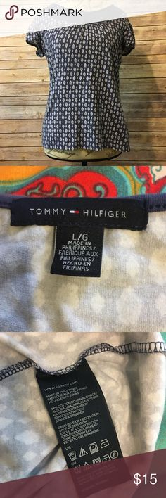 "Tommy Hilfiger navy blue top Large size top. 94% cotton, 6% spandex. Very soft and comfortable fabric. Cute top with button detail and white print. Pit to pit measures around 18"". Tommy Hilfiger Tops Blouses"