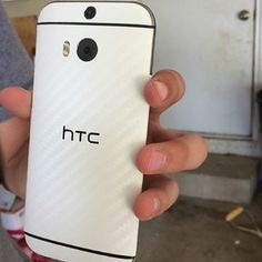White Carbon Fiber for the HTC One (M8). Looks and feels great!!  Photo via Instagram // braden_k_15  #htconem8 #slickwraps #accessories