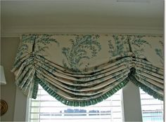 Balloon shade with inverted pleats and trim at bottom