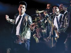 "Star Tracks: Monday, February 3, 2014 | SHOW STOPPER | Bruno Mars brings Motown-style soul to the Super Bowl halftime show at New Jersey's MetLife Stadium, backed up by a metallic-clad crew who blasted out the star's ""Locked Out of Heaven."""