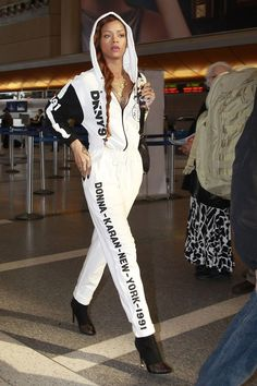 Rihanna in a DKNY  for Opening Ceremony jumpsuit and Alexander Wang boots