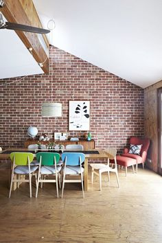 angled exposed brick & colourful chairs