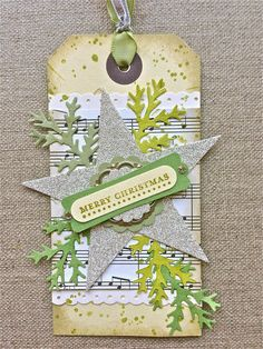 like the silver with acid green (instead of the expected 'gold') and I really like the distressed tag + star and music. Christmas ornament idea!