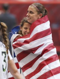 Tobin Heath and Alex Morgan celebrate Team USA's win