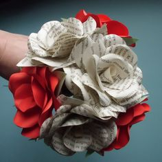 Beautiful handmade paper rose bouquet. This bouquet is made by me and consists of 3 book paper roses & 3 red roses.  All the petals are individually
