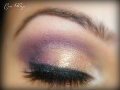 Pretty gold and purple eye makeup.
