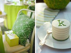 green baby shower; favor box, matching pillows, monogrammed mini cake