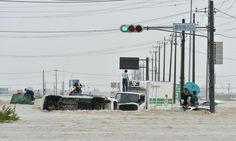 Typhoon Etau: thousands evacuated as severe flooding hits Japan