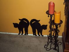 Cat silhouettes made out of foam core boards