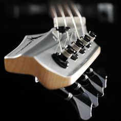 Lodestone Guitars - Primal Pro - Laidback headstock allows for easier access to tuners and supposedly better string path. Nice sculpting of headstock, like rest of guitar.