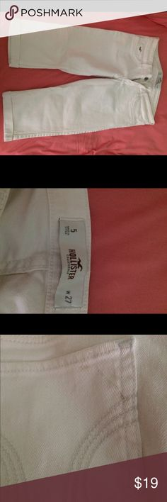 Hollister white cropped pants Only worn a few times and in near perfect condition besides the little dirt stain on the butt shown in the 3rd picture Hollister Jeans Ankle & Cropped
