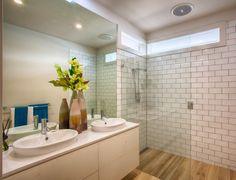 Very modern bathroom with 'floorboard' look floor tiles and 'brick' wall tiles