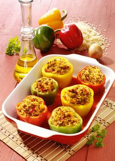 Low cholesterol recipes: Stuffed Peppers  2 yellow peppers 2 green peppers  2 red peppers  2 tomatoes  2 onions  4 tbsp sunflower oil  175 g of rice  1 tsp sugar  paprika  1/2 teaspoon salt  600 ml vegetable stock  4 tbsp tomato puree  200 g ground beef (lean as possible)  1 onion  1/2 clove of garlic  1/2 bunch of parsley  1 egg  nutmeg  250 g of tomato puree