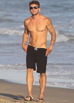 Who needs Baywatch? Ryan Phillippe showed off his toned physique at a beach in Malibu on Monday