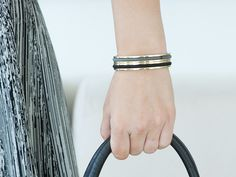 Carry a hair elastic on your wrist in a way that's elegant AND keeps your wrist indent-free. bittersweet by Maria Shireen® bracelets are made of stainless steel with a shiny metallic finish, and they cleverly hold—and disguise—hair elastics. Slip the brac