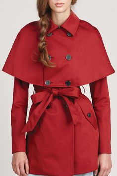 I don't know how this #trenchcoat with #cape would look on me (two nonos for my upper body shape: double-breasted and droopy shoulders), but I am in lust, at least because it is most certainly the perfect shade of #red .