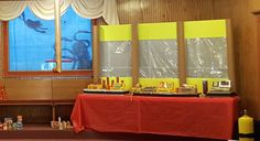We put a tarp over the Baptistry window with silhouettes taped to the backside and lights shining behind. Also the yellow windows are made from carpet rolls, yellow poster board and clear wrappinjg paper, Submerged Vbs, Vbs 2016, Medicine Bottles, White Pencil, Construction Paper, Game Pieces, Scrapbook Paper, Cash Register, Lights