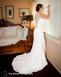 Laura's wedding dress looked amazing on her! Watching her guests arrive from her guest room at Madrona Manor.
