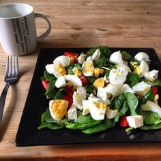 I love this salad!! So easy to make - warm spinach massaged with coconut oil topped with boiled egg, strawberries and laughing cow blue cheese wedges #healthyeats #salad