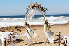 At this point, the professional beach wedding planners can help you to get the most attractive arch in their affordable beach wedding venue packages. Beach Wedding Men, Beach Wedding Makeup, Beach Wedding Colors, Beach Wedding Reception, Beach Wedding Decorations, Beach Weddings, Wedding Arch Flowers, Wedding Planners, Bouquet