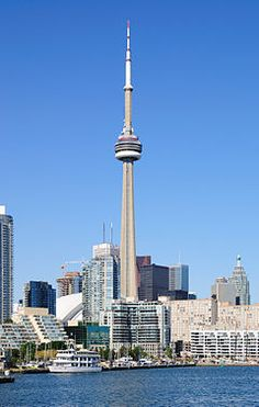 The CN Tower (French: Tour CN) is a communications and observation tower in Downtown Toronto, Ontario, Canada. Standing metres ft) it was completed in becoming the world's tallest free-standing structure and world's tallest tower at the time Torre Cn, Cn Tower, Chrysler Building, Doha, Frank Gehry, Tour Eiffel, Toronto Harbourfront, Canton Tower, Canada Tourism