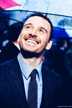 FLASHING THE FANS A FASSY SMILE AT THE GOLDEN GLOBES.