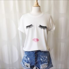 COMING SOON Bat Your Lashes Top Like this post to be notified! Perfect T to dress up or keep casual! Cute eyelash detail. April Spirit Tops Tees - Short Sleeve