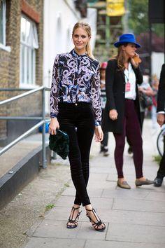 Poppy Delevingne in black velvet trousers..